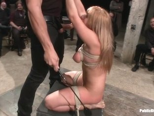Flexible Blonde gets Bound and Fucked for the Crowd