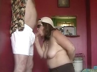 Aged wife sucking and stroking her hubby's dong all at once