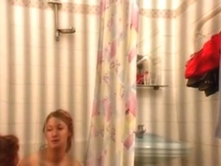 Guy tapes 2 girls naked in the bathroom