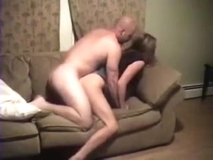 Beautiful wife shared between kinky hubby and his friend on the sofa