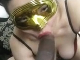 Masked Asian girlfriend devouring black shaft in this oral porn