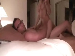 Sexy girlfriend riding geeky dude