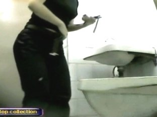 Amateur girls lift up coats and sit pissing on toilet