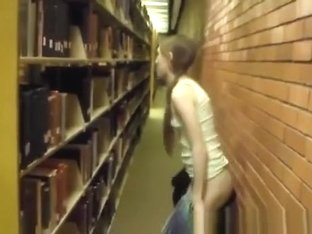 Naked girl in library