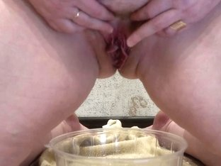 Golden shower of hairy pussy, mature fat milf pissing into a basin. Fetish.