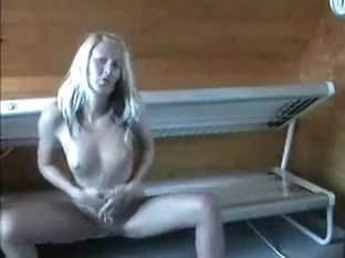 Hot non-professional girl does a great sexy sexy striptease in solarium