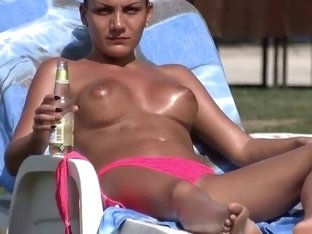 Topless girl smokes and drinks