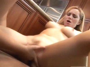 Striking blonde beauties satisfying their lesbian urges in the kitchen