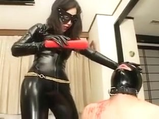 Asian latex catsuit domina whipping her slave hard and hot wax in the end