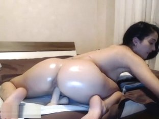 Oiled Up Ass Sits On A Dildo