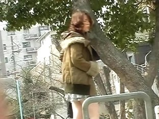 Asian babe in a jacket gets street sharked in a park.