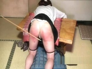 Japanese girl gets a hard caning