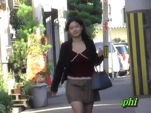 Slender sweetie flashes her booty when some stranger lifts her mini skirt