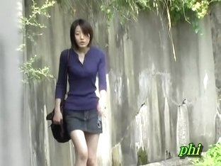 Oriental girl sending text messages as she gets involved in sharking affair