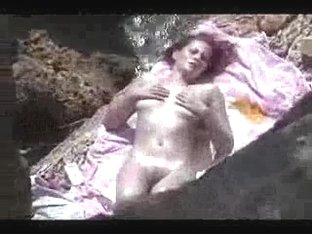 Voyeur video - topless babe on nudist beach