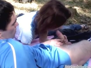 Young amateur couple fucking outside in the woods