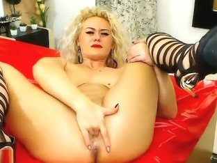 A Blonde Massages Her Pussy