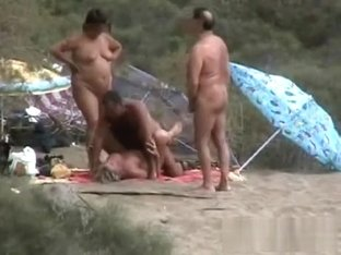 Amateur swingers on the beach
