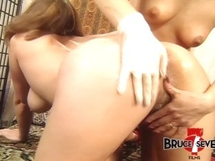 Busty babe ass drilled by horny dyke with huge dildo