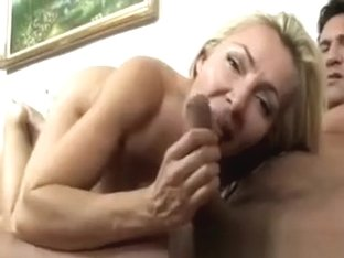 Young Blonde Milf Wanking Male On The Couch