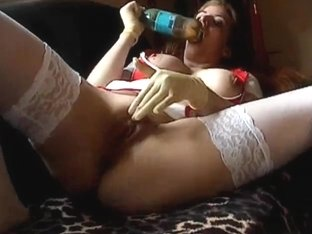 Lovely slut plays with a bottle as a dildo