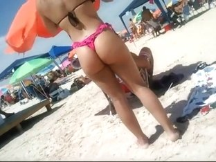 Peeping a big butt in a thong bikini