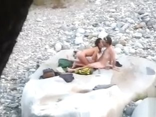 Slim brunette honey enjoys blowing a dick at the beach
