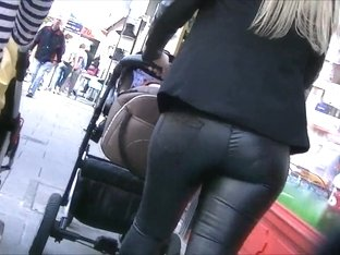 Candid ass in shiny tight leather pants