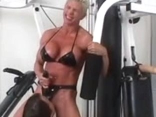 Brawny dyke copulates resigned playgirl with belt on during work out