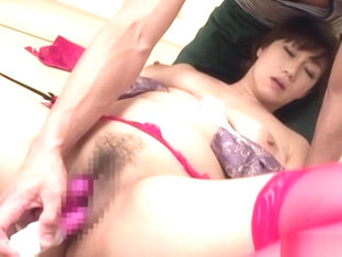 Busty Asian babe on her knees giving sensual head