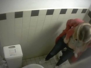 Blonde filmed from above when taking a pee