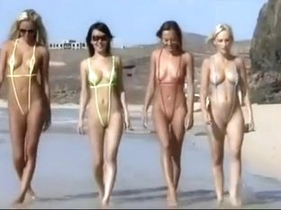 Four hot babes in tiny swimsuits at beach