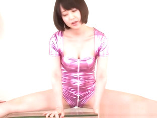 Cosplay flexible gymnast handles sextoy wearing a pink leotard