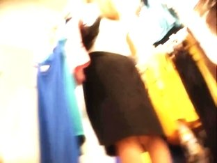 Amateur girl in changing room exciting spy up skirt view