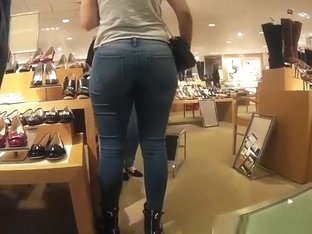 Girl in tight jeans pants at the shoe store