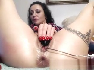 Black milf strips solo and toys her pussy