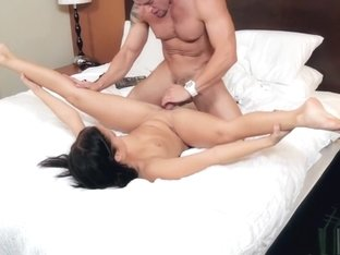 Sexy slender brunette has a handsome guy fucking her pussy on the bed