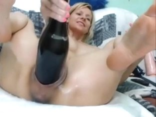Crazy woman fisting pussy with wine bottle