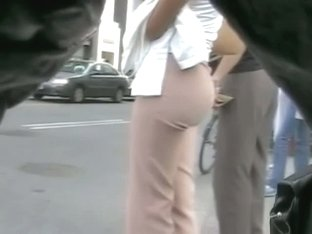 A voyeur following a perfect ass in tight pants on the street