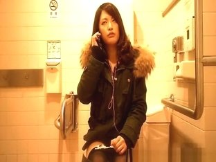 Asian woman spied in toilet peeing