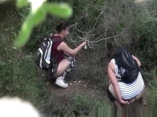Two women caught peeing in the nature