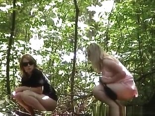 Woman in sunglasses and blonde peeing outdoors