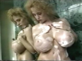 Huge Fake Tits Taking a Bath