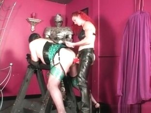 Crossdresser sissy slave is fucked in his ass by strict strapon redhead