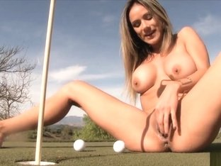Woman Squirts Out Golf Balls And Into Hole