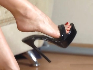 Walking, dangling and losing black H-H mules. Close up.