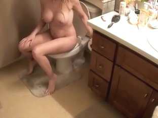 Naked darling is spied while she pissed