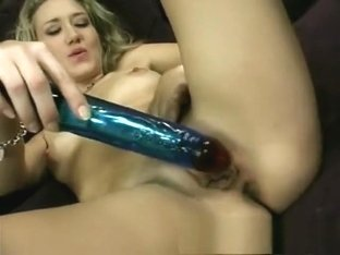 Cute horny blonde spreads her legs so she can slide in her dildo
