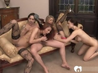 Three girls are sharing his hard pecker together