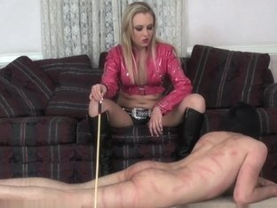 Latex beauty takes her anger out on a guy